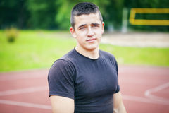 Male teenager on sports ground. In summer  day Stock Photo