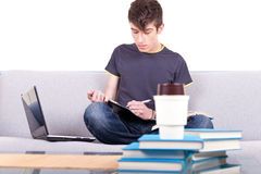 Male teenager studying Royalty Free Stock Photography