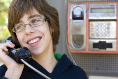 Male teenager talking on phone Stock Photos
