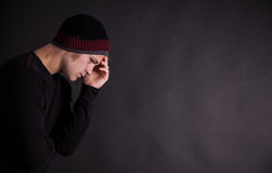Male teenager thinking. With black back ground Stock Photography