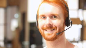 Male telephone customer service operator, happy Stock Photo