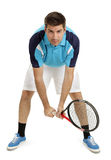 Male tennis player. Photo of an attractive male tennis player waiting for the serve. Full body shot with slight shadow around shoes Stock Photos