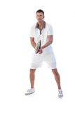 Male tennis player in action. Young male tennis player waiting for ball, concentrating Stock Images