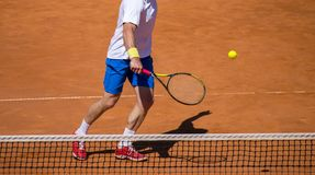 Male tennis player in action on the court on a sunny day.  Stock Images
