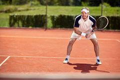Male tennis player on tennis court. Male professionally tennis player on tennis court royalty free stock photos