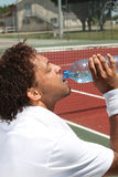 Male tennis player. Drinking water Royalty Free Stock Image
