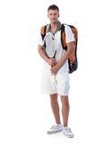 Male tennis player going for training smiling. Handsome male tennis player going for training, holding tennis racket, smiling Royalty Free Stock Images