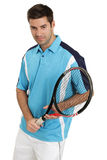 Male tennis player holding racket. Photo of an attractive male tennis player holding his racket royalty free stock photos