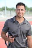 Male tennis player holding racquet Stock Photos