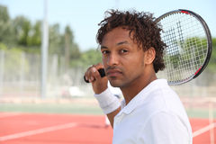 Male tennis player holding racquet Royalty Free Stock Photo