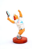 Male Tennis Player Ornament. Painted figurine of a male tennis player waiting for the ball Stock Image