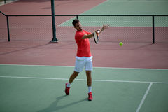 Male tennis player practice in tennis court. In Dubai Royalty Free Stock Photography