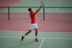 Male tennis player practice in tennis court Stock Photo