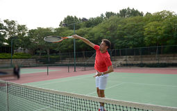 Male tennis player practice in tennis court Stock Photos