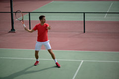 Male tennis player practice in tennis court. In Dubai Royalty Free Stock Image