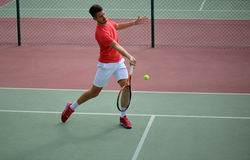 Male tennis player practice in tennis court. In Dubai Royalty Free Stock Images
