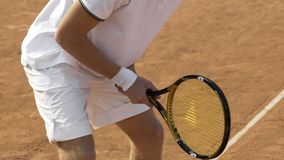 Male tennis player preparing to hit ball, sports competition, active lifestyle. Stock photo stock image