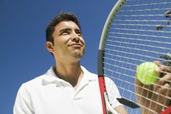 Male Tennis Player Preparing to Serve close up low angle view Royalty Free Stock Photography