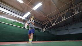 Male tennis player serving the ball. Sport leisure and practice. Indoor court stock video