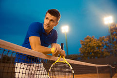Male tennis player standing in the court Stock Image