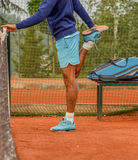 Male tennis player. Stretching before playing Stock Image