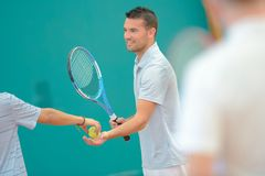 Male tennis player taking ball. Tennis Royalty Free Stock Images