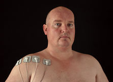Male with tens senors on his body for massage. Photo male with tens senors on his body for massage Royalty Free Stock Photography