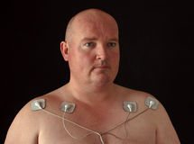 Male with tens senors on his body for massage. Photo male with tens senors on his body for massage Stock Images