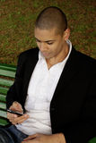 Male Texting. Attractive Young black male Sending Sms, Texting In The Park Stock Photos