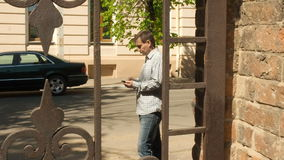 Male texting with smartphone. In the city stock video