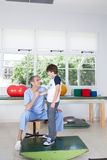 Male therapist with boy in rehab. Therapist with boy in rehab Stock Photo