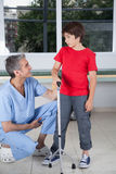Male therapist with boy in rehab. Therapist with boy in rehab Stock Images