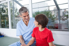 Male therapist with boy in rehab. Therapist with boy in rehab Royalty Free Stock Image