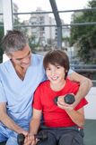 Male therapist with boy in rehab. Therapist with boy in rehab Royalty Free Stock Photos