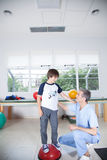 Male therapist with boy in rehab. Man therapist with boy in rehab Royalty Free Stock Image