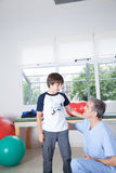Male therapist with boy in rehab. Man therapist with boy in rehab Stock Photo