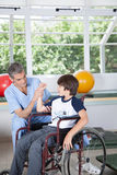 Male therapist with boy in wheelchair. Man therapist with boy in wheelchair Stock Photography