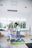 Male therapist with girl in rehab Stock Images
