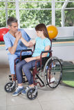 Male therapist with girl in wheelchair Royalty Free Stock Photos