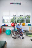 Male therapist with girl in wheelchair Stock Photos