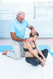 Male therapist massaging pregnant woman. Male therapist massaging pregnant women at clinic Stock Photos