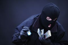 Male thief  the crime scene. Male thief at the crime scene stealing dollars Stock Photos