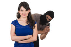 Male thief with gun ready to rob young girl. Male thief with gun ready to rob happy young girl from the back isolated on white Stock Image
