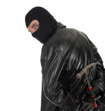Male thief with hammer. Young male thief in balaclava and black leather jacket with hammer Royalty Free Stock Photography