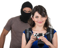 Male thief robbing beautiful young girl Stock Photos