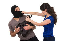 Male thief robbing beautiful young girl Stock Image