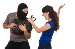 Male thief robbing beautiful young girl Royalty Free Stock Image