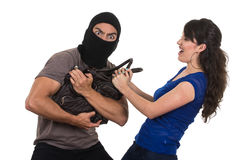 Male thief robbing beautiful young girl Royalty Free Stock Photography