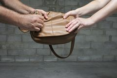 Male Thief Steals Purse from Woman royalty free stock photo