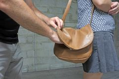 Male Thief Steals Purse from Woman royalty free stock photography